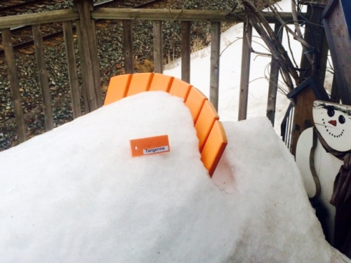 Tangerine Colour Sample on Deluxe Adirondack Chair in Snow